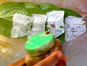 Betel leaves are being prepared